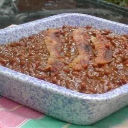 Mom's Baked Beans II Recipe - These beans could be a meal in themselves!  They're baked with bacon,ham, molasses and mustard.
