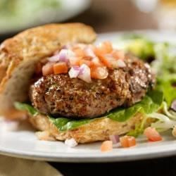 California-Style Ranch Burger Recipe - Juicy, seasoned grilled burgers are topped with a creamy mixture of ranch dressing and sour cream.