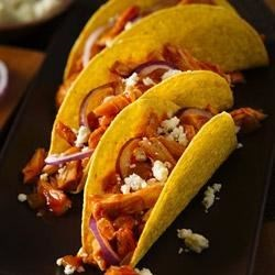 Chicken Tinga Tacos Recipe - Spicy shredded chicken tacos with enchilada sauce and green chiles are ready to eat in 15 minutes.