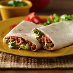 Refried Bean Roll-Ups--Lighter Recipe Recipe - Lighten up!  You can enjoy great-tasting seasoned refried beans, lettuce and cheese in soft flour tortillas and still keep an eye on the fat.