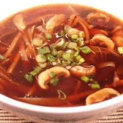 Chinese Spicy Hot And Sour Soup Recipe - Tiger lily buds, shitake and wood ear mushrooms add an exotic quality to this flavorful ground pork and bean curd soup made in a chicken broth with vinegar, white pepper and soy sauce.