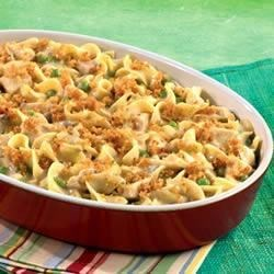 Hearty Chicken and Noodle Casserole Recipe - Chicken, mixed vegetables, noodles and cheese are brought together in this rich and crowd-pleasing casserole.