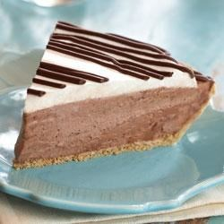 Mocha Mousse Pie from Jif(R) Recipe - The mocha mousse pie filling is topped with whipped cream and drizzled with mocha cappuccino hazelnut spread in this easy and elegant dessert.