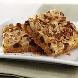 Magic Cookie Bars from EAGLE BRAND(r) Recipe - This bar cookie is an old fashioned favorite. Chocolate chips, nuts and coconut are set in a caramelized layer on top of a graham cracker crust.