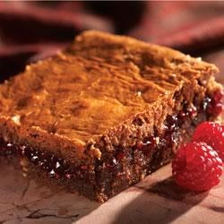Raspberry Brownies Recipe - A layer of raspberry preserves is at the center of these rich brownies.