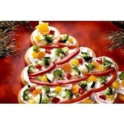 Tree-Shaped Crescent Veggie Appetizers Recipe - Veggie trays, move over! This colorful tree-shaped appetizer will add an interesting twist to your appetizer buffet.