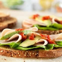 Turkey and Avocado Sandwiches Recipe - Just a few slices of avocado and a kick of salsa takes ordinary turkey sandwiches to a whole new level of deliciousness!