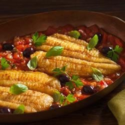 Fish Fillets Provencal Recipe - Browned fish fillets simmer in a sauce of fresh tomatoes, parsley, basil, thyme, and garlic, bringing the flavors of the French countryside to the dinner table.