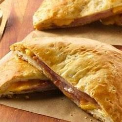 Grands!(R) Ham and Cheese Melts Recipe - A flattened refrigerated biscuit is the perfect pairing for layers of deli ham and cheese in a hot sandwich that can't be beat.