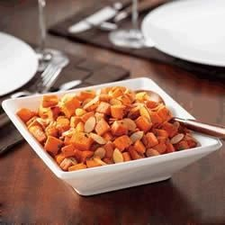 Roasted Almonds Sweet Potatoes Recipe - Sweet potato chunks are roasted with fresh thyme and combined with sliced California Almonds to make a hearty side dish.