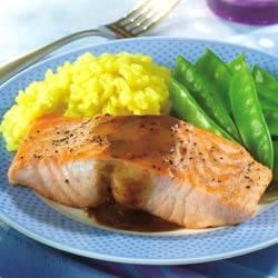 Salmon Fillets with Mustard Glaze Recipe - Tender, sauteed salmon is glazed with a tangy sweet-sour glaze.