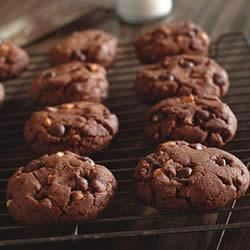 Peanut Butter Cocoa Cookies Recipe - Lots of peanut butter, cocoa, and chocolate chips make these cookies a great lunchbox or after-school treat.