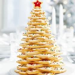 Holiday Cookie Tree Centerpiece Recipe - Graduated sizes of holiday star cookies are artfully stacked to form this festive (and edible!) Yuletide centerpiece.