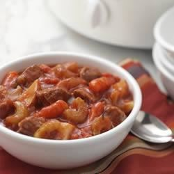 Slow Cooker Beef Stew Recipe - Tender onions, carrots and potatoes slow cooked with chunks of beef in a beefy tomato broth.