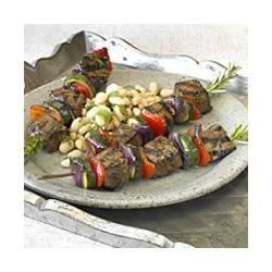 Teriyaki Rosemary Beef Kabobs Recipe - Chunks of top sirloin, marinated in teriyaki sauce and fresh herbs, are grilled with fresh veggies for kabobs that are loaded with flavor.