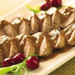 Pork Tenderloins with Asian Peanut Sauce Recipe - Pork tenderloins are roasted then sliced into medallions and topped with an Asian-inspired peanut sauce for a simple but elegant main dish.