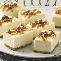 PHILLY Caramel Cheesecake Bars Recipe - Take cheesecake bars over-the-top with a drizzle of caramel and a dusting of chopped pecans.
