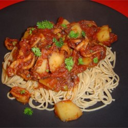 Octopus in Tomato Sauce Recipe - Enjoy this traditional recipe from Malta which makes a very flavorful sauce for octopus with potatoes, tomatoes, red wine and a hint of citrus that can be served over spaghetti, or just on its own.