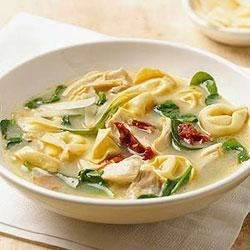 Tortellini Florentine Soup Recipe - Try this delicious soup recipe that combines Classico(R) Light Creamy Alfredo pasta sauce, baby spinach, chicken, and tortellini. It's ready in under 30 minutes and perfect for weeknight.