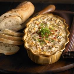 Warm and Creamy Bacon Dip Recipe - Dig into this creamy bacon and Cheddar dip with crisp veggies, crackers, and chips.