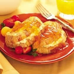SMUCKER'S(R) Stuffed French Toast Recipe - Thick French bread slices are stuffed with a fruity cream filling before being lightly battered and fried. A sweet glaze of orange juice and SMUCKER'S(R) Apricot Preserves is drizzled over for the finishing touch.