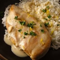 Creamy Lemon Chicken Recipe - Lemon juice and grated lemon peel add an unexpected flavor kick to a simple chicken skillet supper.
