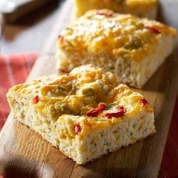 Bacon, Herb and Cheese Snack Bread Recipe - Italian herbs, shredded cheese, and chopped bacon combine for a delicious snack or sandwich bread.