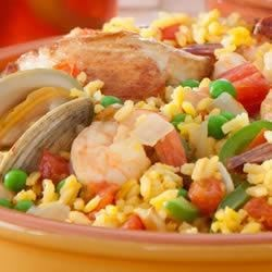 Paella by Filippo Berio(R) Recipe - This Spanish-inspired shellfish, chicken, vegetable, and rice classic is seasoned with savory herbs and spices and is easily prepared in the oven.