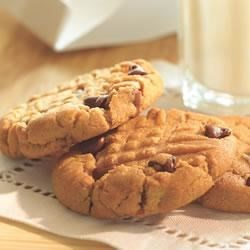 Chocolate Chip Peanut Butter Cookies Recipe - Chocolate chips, peanut butter, and a hint of almond combine their great flavors in these sweet treats.