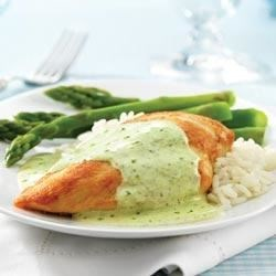 Creamy PHILLY Pesto Chicken Recipe - Add a bit of cream cheese to purchased pesto for a spicy herb sauce that really dresses up sauteed chicken breasts.