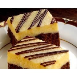 Brownie Cheesecake Bars Recipe - You'll get two dessert favorites in one with these sweet treats where creamy cheesecake is layered atop fudgy, nutty brownies.