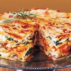 Mile-High Lasagna Pie Recipe - This layered beauty is stacked with fresh vegetables, baby greens, aromatic herbs, three kinds of Italian cheeses, and Classico(R) Four Cheese pasta sauce. It's ideal for a special-occasion dinner.