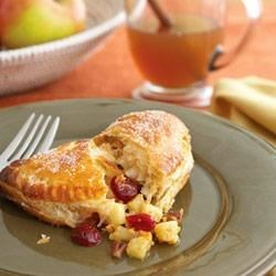Honeycrisp Apple, Cheddar and Cranberry Turnovers Recipe - Cheddar cheese is the perfect complement to the sweet fruit in these mouthwatering puff pastry turnovers. What a sophisticated dessert!