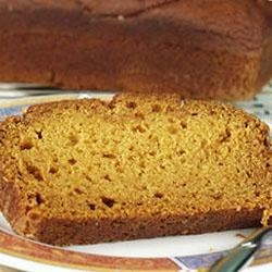 Pumpkin Bread I Recipe - These two loaves of fragrant pumpkin bread made with butter and whole wheat flour can be used in a bread stuffing for turkey or served sliced plain or spread with butter and preserves.