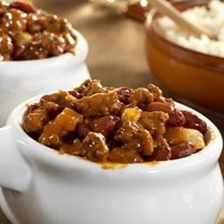 Campbell's(R) Healthy Request(R) Chili and Rice Recipe - Beef and beans are simmered in an onion and chili powder spiked tomato sauce and served over rice.