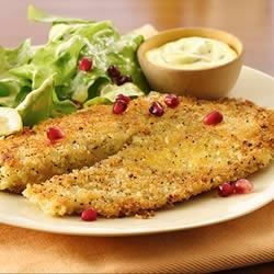 Seared Lemon Pepper Tilapia with Creamy Pumpkin Seed Vinaigrette Salad topped with Pomegranate Seeds Recipe - Lemon pepper tilapia fillets are served with a crisp butter lettuce salad tossed with bright pomegranate seeds in homemade pumpkin seed vinaigrette.
