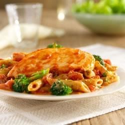 Hunt's(R) Tomato and Pesto Chicken Recipe - Chicken breasts, simmered in tomato sauce, served with pasta and broccoli tossed with a creamy tomato-pesto sauce.