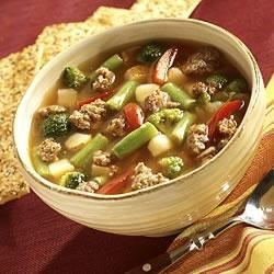 Slow Cooker Sausage Vegetable Soup Recipe - This delicious vegetable and sausage soup can be quickly assembled before work and ready to eat when you get home.