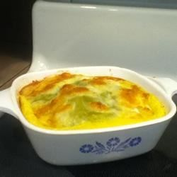 Green Chili Casserole Recipe - Layers of canned green chiles and cheddar cheese are baked with an egg filling. This casserole is also great when made with fresh long green chiles. Makes a wonderful brunch dish, but we also have it for lunch quite often.