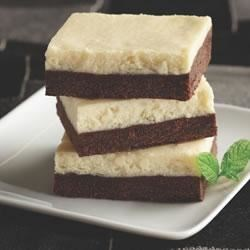 Chocolate Cheesecake Bars from Crisco Baking Sticks(R) Recipe - Two delicious layers--one rich chocolate, the other creamy vanilla--bake up into elegant dessert bars.