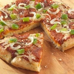 Quick Fix Pizza Recipe - Scrumptious pizza is easy to prepare at home when you use Sister Schubert's Parker House Style Rolls.