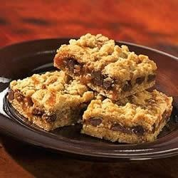 Smucker's(R) Oatmeal Carmelitas Recipe - These decadent oat bars are packed with chocolate chips, nuts, and gooey caramel.