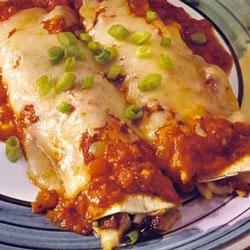 Italian-Style Enchiladas Recipe - Blend flavors of Mexican with Italian in this chicken, Classico(R) Tomato and Basil pasta sauce, and cheese mix rolled into tortillas.