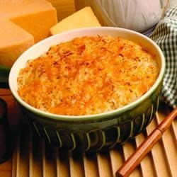 Bob Evans(R) Au Gratin Potatoes Recipe - This creamy casserole is made of hash brown potatoes, Cheddar and Parmesan cheeses, milk, and butter.