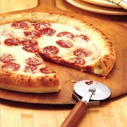 Stuffed-Crust Pizza Recipe - How clever! Roll Pillsbury(R) refrigerated pizza crust around string cheese for a pizza with pizzazz.