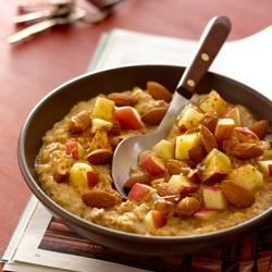 Hearty Apple Almond Oatmeal Recipe - Oatmeal with almonds and apple chunks makes a deliciously filling breakfast when you're in a hurry.