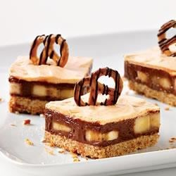 Chocolate, Peanut Butter and Pretzel Bars Recipe - Creamy, peanut-butter and chocolate layers with sliced bananas make a delicious snack bar treat.