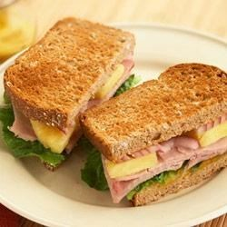 Hawaiian Ham Sandwiches Recipe - Pineapples on a sandwich? You bet! This tasty combination is as refreshing as a tropical breeze.