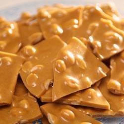 Caramel Peanut Brittle Recipe - Buttery and sweet, crisp and crunchy--peanut brittle is an irresistible snack, and simple to make at home.