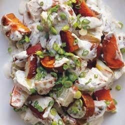 Grilled Herb and Garlic Triple Potato Salad Recipe - Three kinds of potatoes, grilled in foil packets until tender, are tossed together with a creamy herb and garlic sauce and sliced green onions.